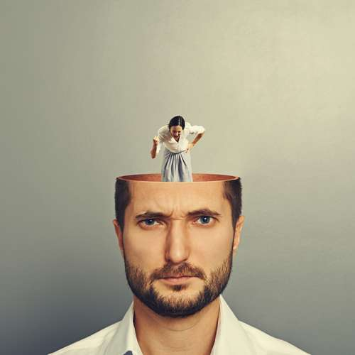 Photo of man's head with woman scolding